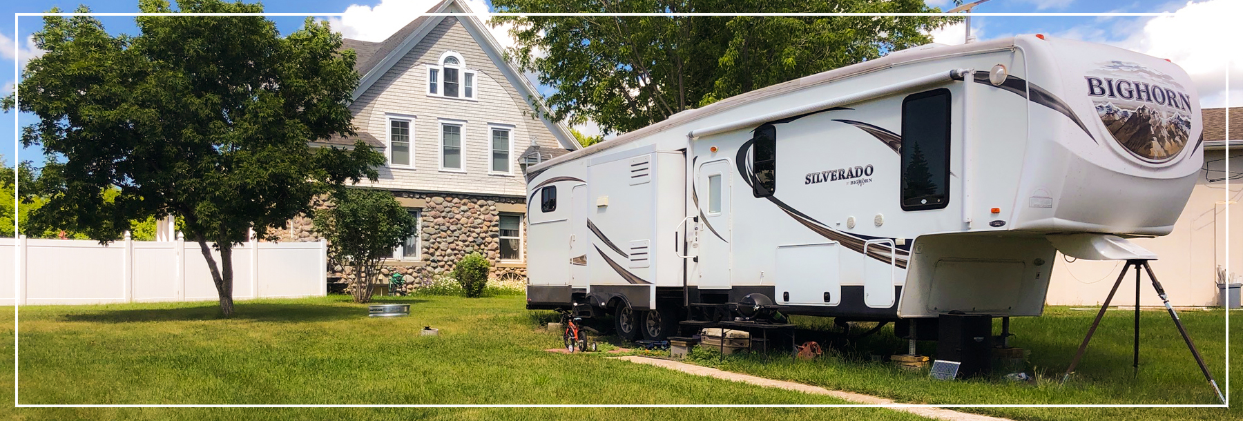 A summer time photo of the main, on-site office of Stonehouse RV Park, in Stanley North Dakota.